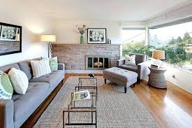 living room with stone fireplace sofa metal ottoman west elm jute rug clay chair ivory platinum rug for living room either ivory or flax color jute boucle