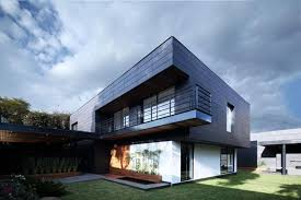 exterior home building materials. its ventilated facade is covered with ceramic panels, green building material made from terracotta. the exterior panels provide warmth and home materials ,
