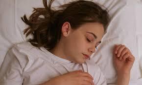 Sleeping teen blonde surprised by