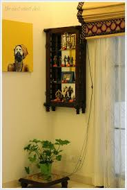 A section of the dining room has been dedicated as the pooja corner. An  antique wooden yala (cradle) has been innovatively used as a pooja shelf