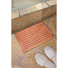 Cozy-lowes-tile-flooring-with-teak-bath-mat-