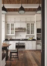 glass cabinets with solid cabinet doors on top love the floors