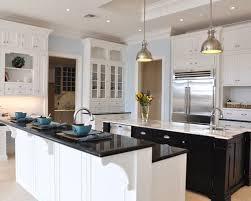 kitchen bar lighting. elegant beige floor kitchen photo in orlando with stainless steel appliances and two islands bar lighting i