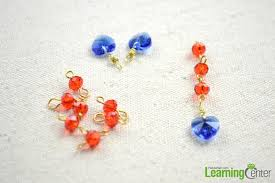 hook three of the abacus glass bead elements and then one heart shape pendant make three groups step4 assemble your diy earrings