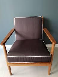 Sleek Wooden Sofa Designs Pencil Legs Single Seater Sofa