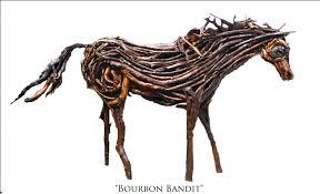 found wood horse sculptures