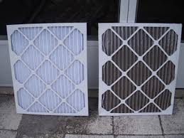 air conditioning filters. the right is a clean flow filter used and left new. air conditioning filters t