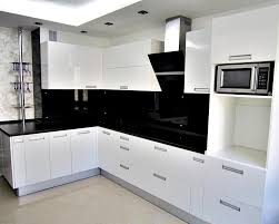 open kitchen design with white glossy cabinet and black granite countertop backsplash along with lighting idea in ceiling