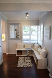 Create an easy window seating area with pillows for comfort, and baskets  for decorative storage