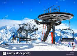 ski lift chairs on bright winter day stock image