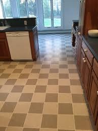 laminate floor installation old linoleum floor looking into the kitchen