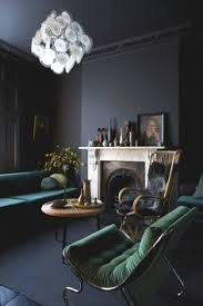 living room emerald furniture with black walls and fireplace milk magazine home of jo graham atkins hughes via apartment therapy
