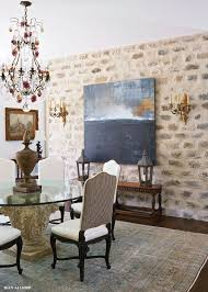 formal dining with mortar washed stone fireplace