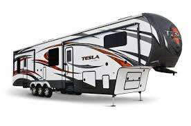 middlebury ind luxury moves in and takes up residence in the new t3970 model in the tesla series of toy hauler fifth wheels from evergreen recreational