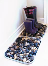 Make a Martha-inspired river rock boot tray with a few large serving trays  and several bags of river rocks. Su at Vively Online shared this clever and  chic ...