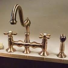 Bellevue Bridge Kitchen Faucet with Brass Sprayer Lever Handles