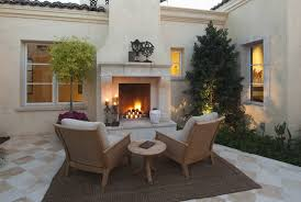 outdoor fireplace design at rustic luxury home