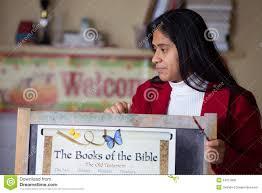 Hispanic Home School Teacher With Bible Chart Stock Photo Image Of