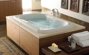 jacuzzi style bathtubs also referred to as whirlpools are a must have in any luxury bathroom remodel but many people only factor in the additional