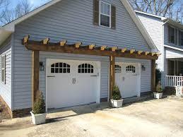 vinyl arbor over garage door trellis above