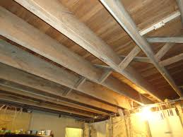 Unfinished basement ceiling fabric Kid Friendly Image Of Insulate Basement Ceiling Raysoflifeinfo Unusual Ideas Basement Ceiling New Home Design