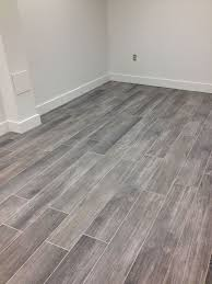 gray wood tile floor no3lcd6n8 homes bathroom floors tiles 736x981 most visited flooring and woods