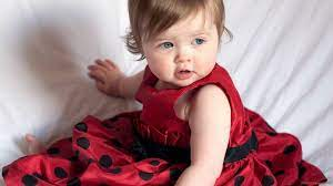 Cute Girl Baby With Ash Eyes Is Sitting ...