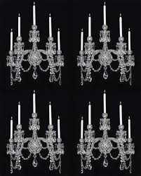 a highly important set of four cut glass english wall lights by f c osler of