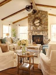 best farmhouse living room with a stone fireplace surround design ideas remodel pictures houzz