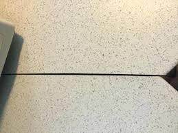 photo of slot routed in edge miter section laminate countertop seam filler assemble laminate seam countertop repair