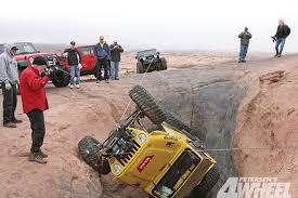 131 0904 01 z 4x4 truck winch tips jeep in ditch photo 15080963 4x4 truck winch tips jeep in ditch photo 01