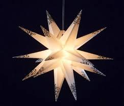Deco Plant Weihnachtsstern 18 Zacker Aus Kunststoff Für Innen Außen Dekoration ø 50 Cm In Weiß Mit Schwarzem Ornament Design An Den Spitzen