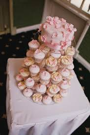 Pink Flower Cutting Cake And Cupcake Tower A Wedding Cake Blog