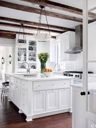 home by darryl carter reclaimed oak beams shelter the kitchen which is equipped with a viking hood and cooktop and calacatta gold marble counters