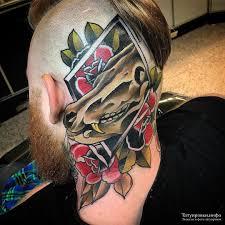 череп животного с листьями роз фото тату на затылке Tatuirovkiinfo