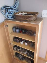 Storage For Kitchen Cabinets Turning A Kitchen Cabinet Into Shoe Storage