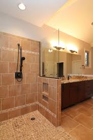 this master bath features a his and hers design with separate vanities and separated shower heads on each end of the shower the shower is handicapped