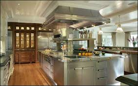 by working with steel you can reflect the various surfaces in your kitchen to create an illusion that makes the room appear much larger and brighter