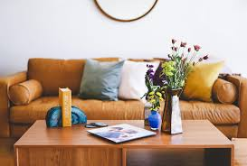 a coffee table is always the center of attention in the living room area it can display knick knacks like candles or figurines and can also carry larger