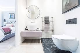 en suite bathroom with marmo nero hex floor tiles by domus
