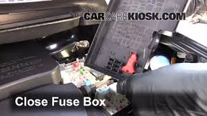 replace a fuse 2013 2016 ford escape 2013 ford escape sel 2 0l 6 replace cover secure the cover and test component