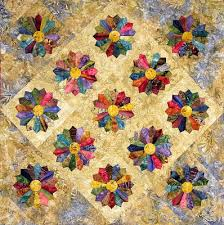 Quilt Inspiration: Dresden Plate Quilts & Edyta Sitar, author of the fascinating Friendship Triangles and Hop To It  books, shows us a contemporary Dresden Plate quilt, using rich, deep batik  colors. Adamdwight.com