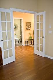 go in two diffe directions laminate flooring two rooms meet house floors met room and flooring ideas