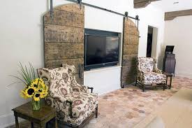 we love this diy sliding barn door tv cover from liz marie beautiful solution to how to hide a tv