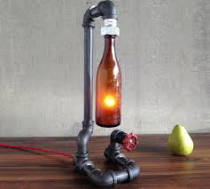 bottle lighting. This Vintage Lamp Is Made Using An Old Antique Beer Bottle Along With Some Industrial Piping And Illuminated By A Low-wattage Bulb That Placed Inside Lighting