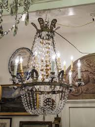 19th century french empire chased bronze and crystal basket form chandelier with six lights it