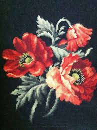 needle point wall hanging black rust