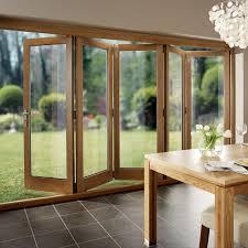 solid oak timber folding kitchen door opening towards garden
