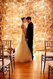 loving the beautiful backdrop of lights the bride and groom sharing an intimate moment