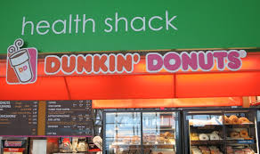 new york city a photo essay rachel s ruminations a dunkin donuts sign under a sign reading health shack at kennedy airport in